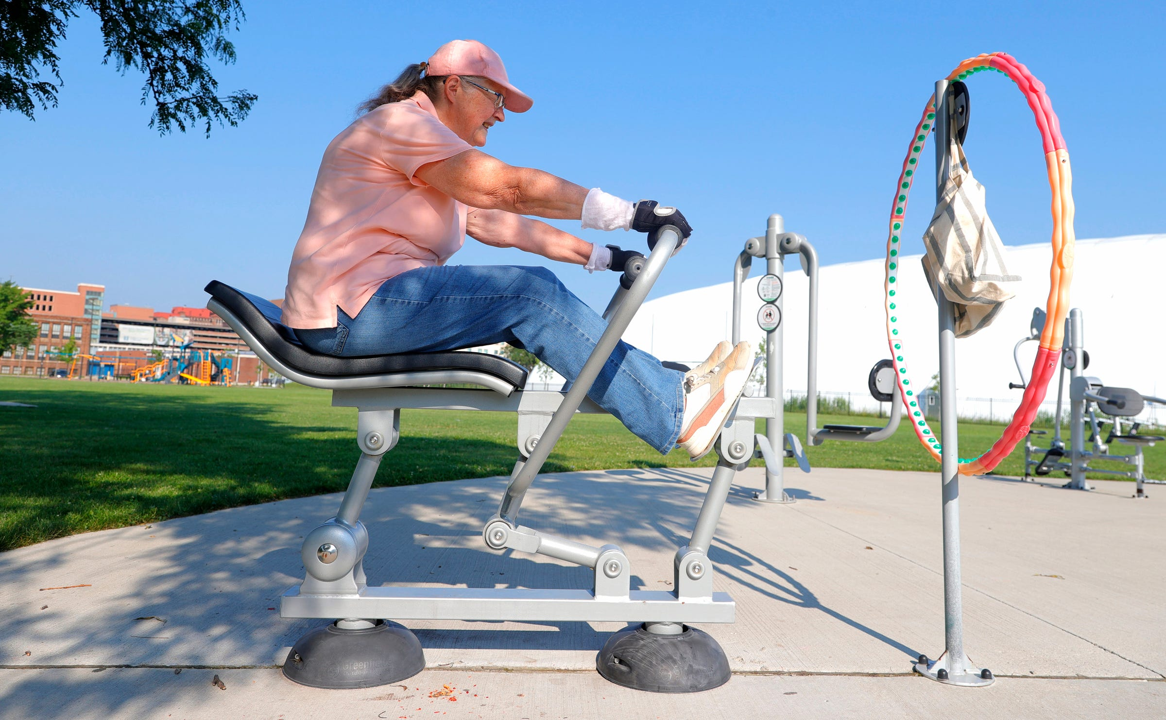 Margaret England works out on a rower machine at Tolan Park by the I-75 service drive and Mack Avenue on July 28, 2021. England, who comes here a few times each week, puts in up to two hours on the various workout equipment that's free for the public to use. She's been on a mission to get and stay fit.