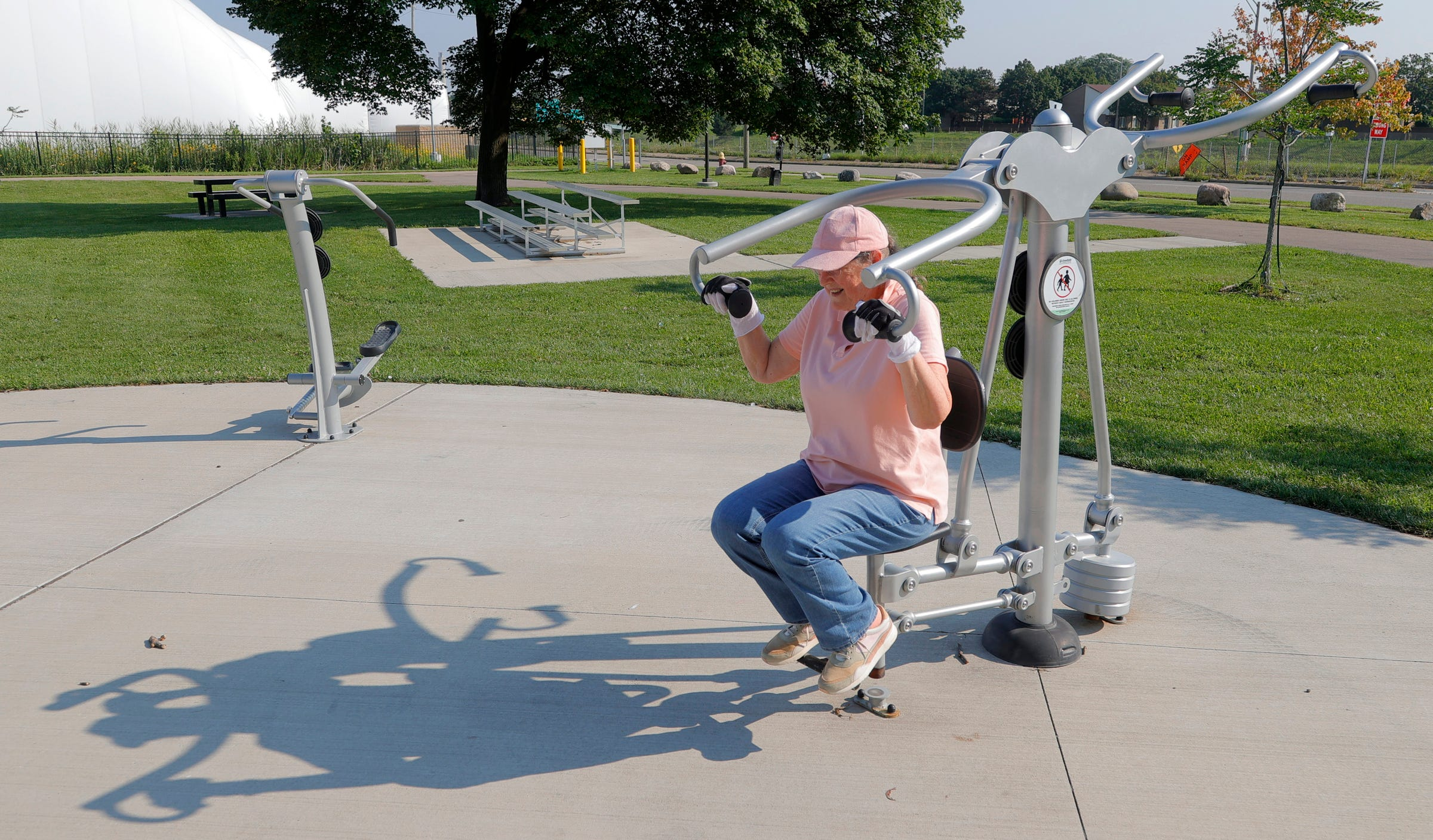 Margaret England works out on various fitness machines at Tolan Park by the I-75 service drive and Mack Avenue on July 28, 2021. England, who comes here a few times each week, puts in up to two hours on the various workout equipment that's free for the public to use. She's been on a mission to get and stay fit.