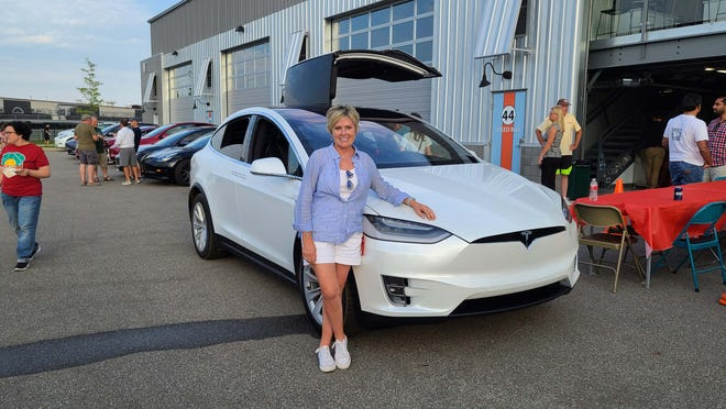 Erin Oldford loves her Tesla Model X. She joined the Tesla Owners Club of Michigan for its first cruise down Woodward.