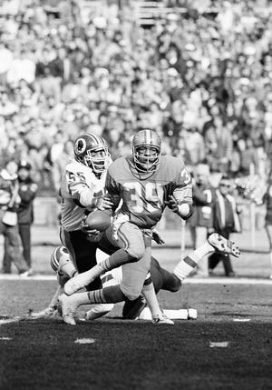 Detroit Lions wide receiver Leonard Thompson attempts to head up field as Redskin linebacker Mel Kaufman tries to dislodge the ball during their game at RFK Stadium in Washington, Jan. 10, 1983. Thompson caught seven passes for 150 yards. The Redskins defeated the Lions 31-7 in the first round of the NFC playoffs.