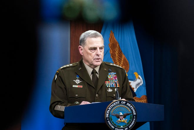 Joint Chiefs Chairman Gen. Mark Milley speaks during a media briefing at the Pentagon, Wednesday, Aug. 18, 2021, in Washington. Milley's image is displayed on television camera monitor as he speaks at top. (AP Photo/Alex Brandon)