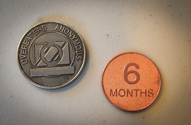 Coins are given to people who join Overeaters Anonymous to celebrate milestones in their recovery. The coins are powerful, tangible proof of their ongoing success.