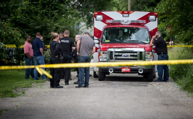 Police officers and other emergency responders gather along Brady Street where the body of a 25-yearl-old Muncie man, Deondre D. Johnson, had been found on June 7, 2019. Investigators said Johnson had been shot to death.