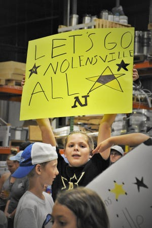 Lucas Bivens, 12, shows his support for the Nolensville Little League team at a pep rally and fundraiser for the team in Nolensville, Tenn., at Mill Creek Brewing Co. on Aug. 8, 2021.