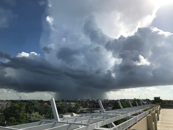 An August 2021 thunderstorm as seen from the downtown area parking garage in Naples, where homes are becoming less affordable for many.
