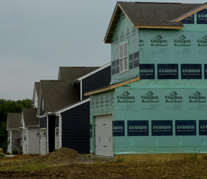 Homes in various stages of construction on Ephraim Drive, just north of Ohio 16 in Pataskala. The city's population increased 19.5% in the last decade, to 17,886 residents.