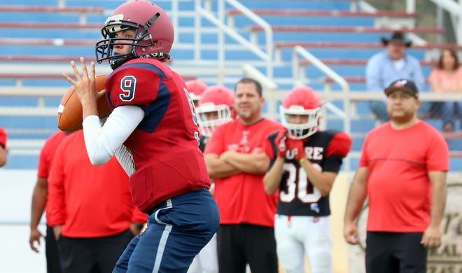 Senior Wildcat quarterback Tony Aguilar (9) is expected to provide leadership for the Deming High varsity.