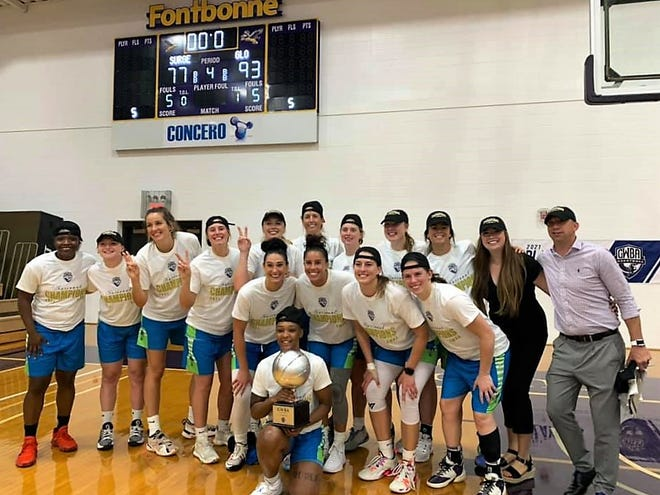 Wisconsin Glo players and staff pose after winning their second consecutive Global Women's Basketball Association championship.
