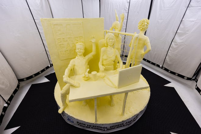 """""""Back to Play,"""" one part of this year's butter sculpture at the New York State Fair."""