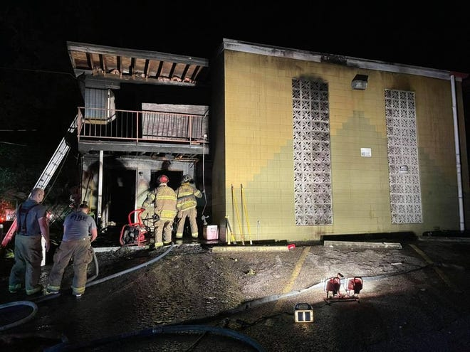 Firefighters responding to a fire at a Tallahassee apartment complex just before 3 a.m. Thursday morning.