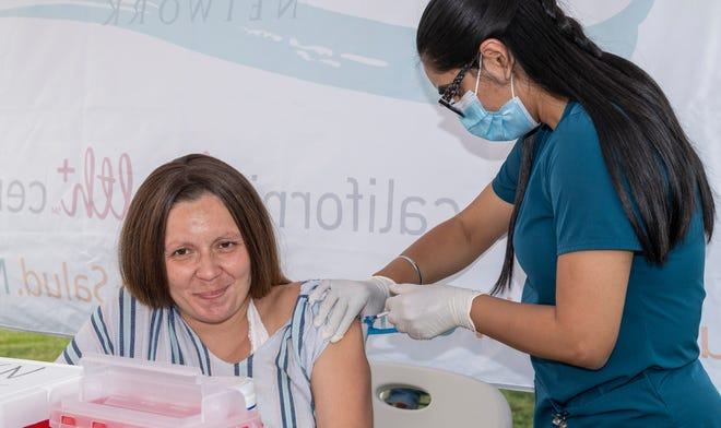 Medical student Gujit Mundh injects Moderna vaccine during a COVID vaccination clinic for the homeless in Tulare on Thursday, August 19, 2021.