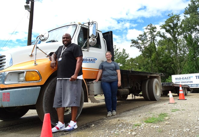 Ron Howard and Rhiannon Shaw are students in the truck driver training program at Mid-East Career and Technology Centers. Local companies see promise in trade school enrollment to combat the a prominent truck driver shortage, but the demand is expected to increase for years to come.