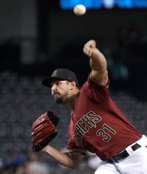 Arizona Diamondbacks starting pitcher Caleb Smith throws against the Philadelphia Phillies in the sixth inning at Chase Field.