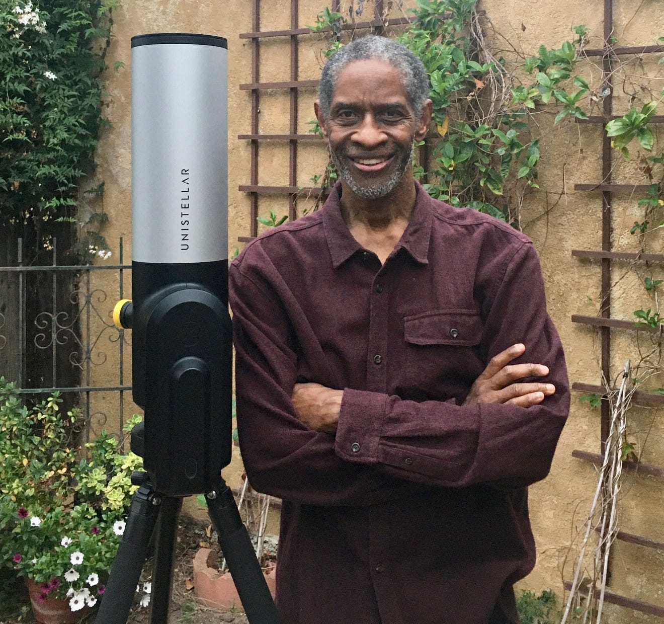 Tim Russ from Star Trek: Voyager poses with his backyard telescope
