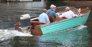 Ken Shumaker, 81, front left, talks with his brothers Jim, 78, and Dick, 80, as they head out for a ride Aug. 18 on Turkeyfoot Lake aboard their 1956 Cruisers Holiday in New Franklin. The Akron brothers saved money from their Beacon Journal paper routes in the 1950s to purchase the boat, which will be featured at the Portage Lakes Antique & Classic Boat Show.