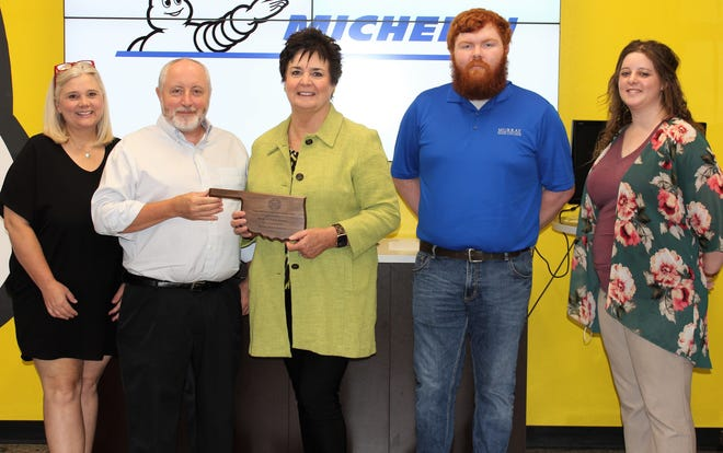Murray State College President Joy McDaniel, (middle), is joined by Michelin Plant Administration Manager Andy Isbell (second from left), MSC Associate Vice President for Academic Affairs Ginger Cothran (left), MSC Manufacturing Technology Instructor Bretton Pollock (second from right) and MSC Advancement Coordinator Jordyn Frazier (right). President McDaniel was on hand to present Michelin with a plaque as part of the Oklahoma State Regents for Higher Education Business Partnership Excellence Award program which recognized the collaboration between MSC and Michelin. The annual awards are designed to highlight successful partnerships between higher education institutions and businesses which are cultivating the higher education learning environment.