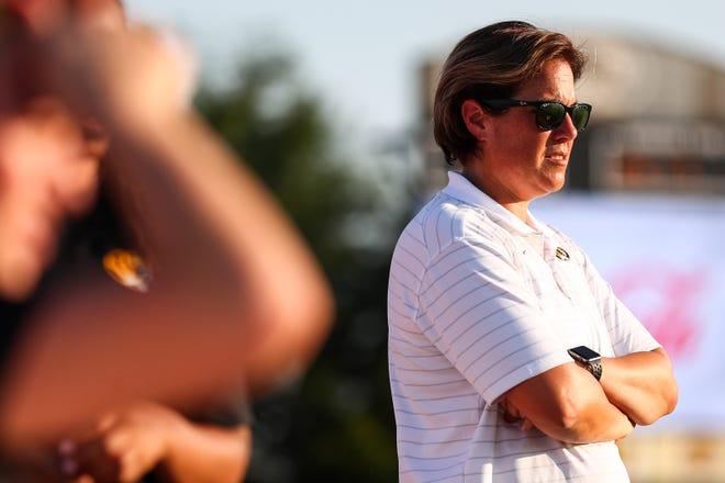 Missouri head soccer coach Stefanie Golan watches warmups before a match against Illinois on Thursday at Walton Stadium.