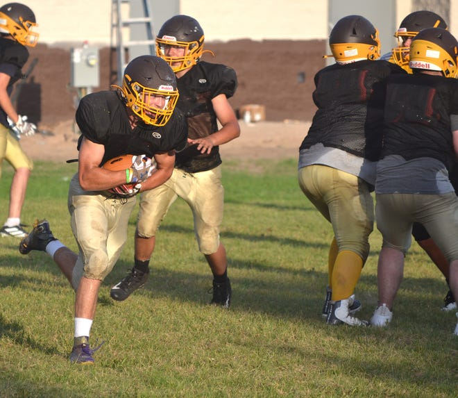 Pellston junior Garrett Cameron runs the ball during a recent team practice in Pellston. Cameron is one of the top returning players for the Hornets this fall.
