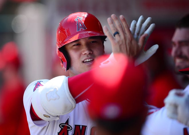 Shohei Ohtani leads baseball with 40 home runs and is 8-1 as a pitcher.