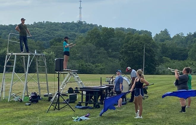 Cambridge High Band Director Ricky Harvey, l, directs a summer marching practice practice outside Cambridge Intermediate School as the Bobcats prepared for the 2021 season. Band directors are hopeful they will get a full season after the COVID-19 pandemic canceled numerous shows and performances in 2020.
