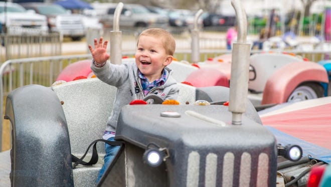 This boy seems to be really enjoying a ride at the GFDS Fair./ GDS Fair photo
