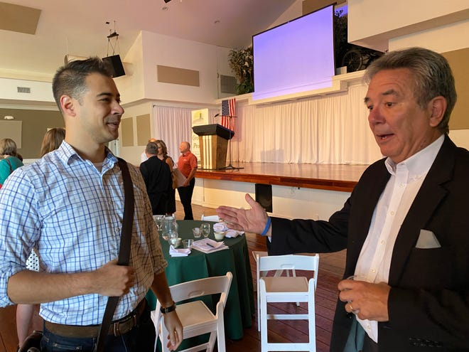 Mike Ross, president of Franklin County Area Development Corp., right, talked with Christopher Wong of Paragon Engineering Services after the Greencastle-Antrim Chamber of Commerce breakfast on Aug. 19.