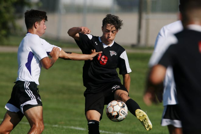Southeastern Community College's Pedro Bernardino (19) moves the ball down the field during their game against Iowa Wesleyan University Wednesday Aug. 18, 2021, at the Burlington Regional RecPlex.