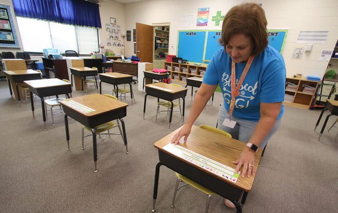 Teacher Robin Wilson gets her classroom ready for the start of school Friday morning, August 20, 2021, at West Elementary School in Kings Mountain.