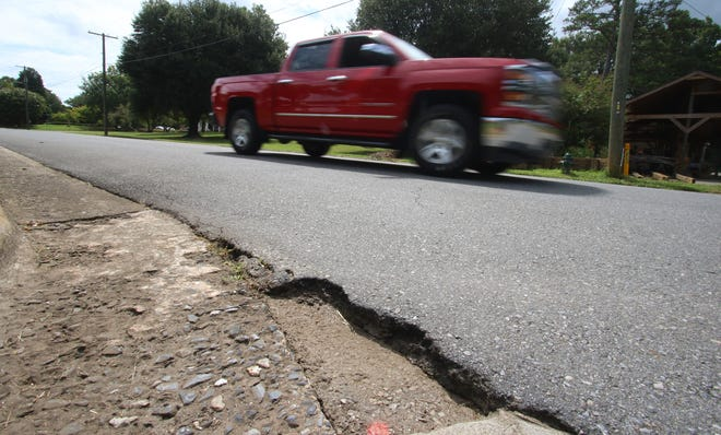 Chipped pavement along the 900 block of West Sumter Street in Shelby Friday afternoon, August 20, 2021.