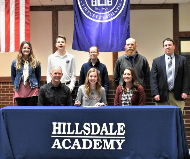 Picture standing left to right:  Assistant Cross Country and Track Coach Katherine Anderson, brother Grant Walton, sister Ella Walton, Head Cross Country Coach Michael Nikkila, Head Track and Field Coach and AD Mike Roberts.  Sitting, father Dr. Kevin Walton, Claire Walton, and mother Barb Walton.