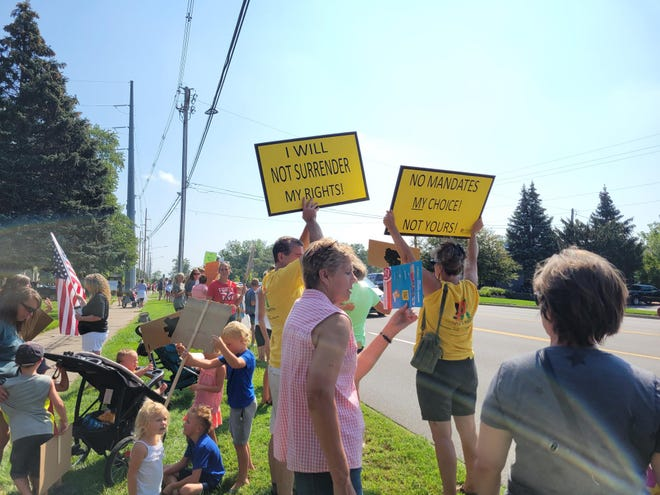 Protesters gathered outside the Ottawa County Department of Public Health building Friday afternoon to oppose a mask mandate in schools. Hours later, OCDPH issued a pre-K-6 mask requirement.