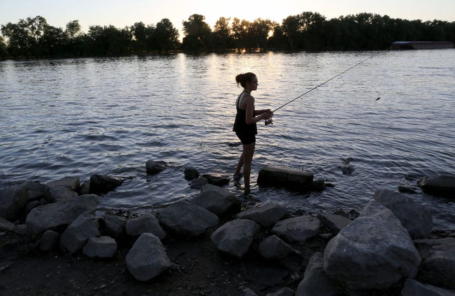 Isabelle Weaver fishes in the Illinois River in Havana, Illinois, in 2015.