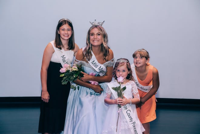 Elora Elizabeth Russell, Miss Monroe County Outstanding Teen 2021, is flanked by her 2021 Princess Court. Pictured are: (from left): Olivia Presley Haase, Elora Elizabeth Russell, Ahlona Jean Hayter and Cheyanne Rose Hipkins. Photo by The Photobook, LLC