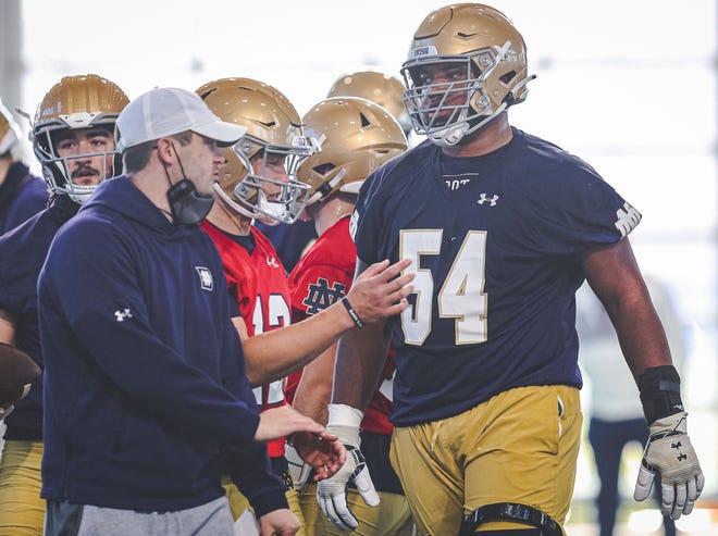 Notre Dame left tackle Blake Fisher (54) remains on track to become the second Irish freshman offensive lineman in 50 years to start a season opener.