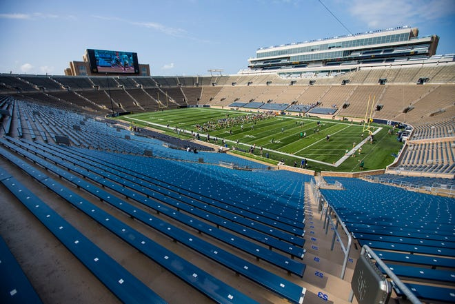 Irish players warm up before football practice Thursday, Aug. 19, 2021 at Notre Dame Stadium in South Bend.