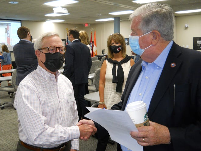 Alan Liby, left, talks to Lt. Gov. Randy McNally at the East Tennessee Economic Council meeting last Friday, Aug. 20, 2012. Pictured behind them is Cindy Boshears, service academy coordinator for U.S. Congressman Chuck Fleishmann, R-Third District.
