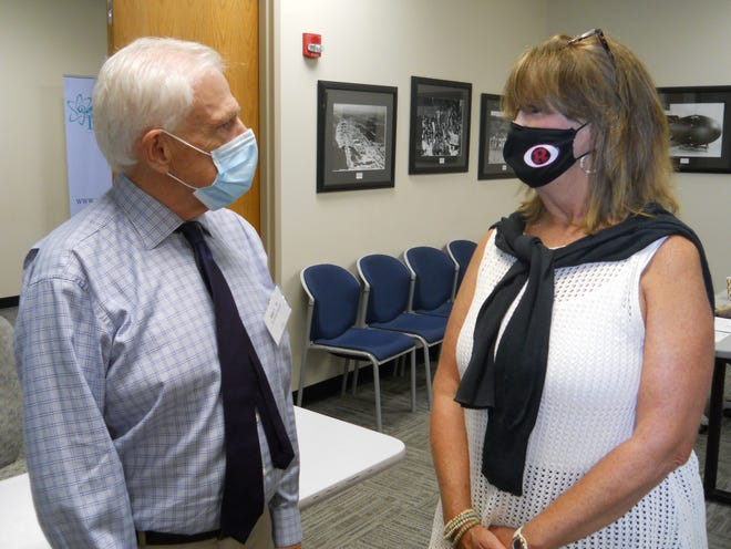 State Rep. Ken Yager talks to Cindy Boshears, service academy coordinator for Chuck Fleischman, R-Third district, after the East Tennessee Economic Council event announcing results of a study about Oak Ridge.