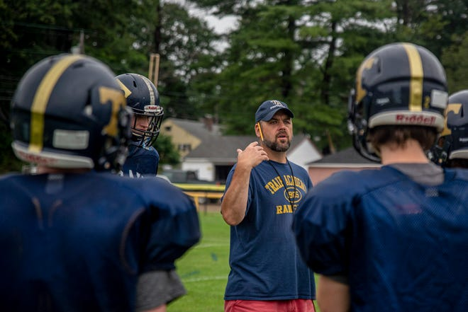 Traip Academy football coach Eric Lane talks to his players during a recent practice at Memorial Field in Kittery, Maine. Traip will kick off its 8-man South schedule on Saturday, Sept. 4 at home against Telstar Regional.