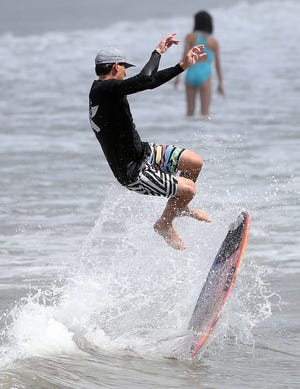 A surfer goes airborne at Narragansett Town Beach.