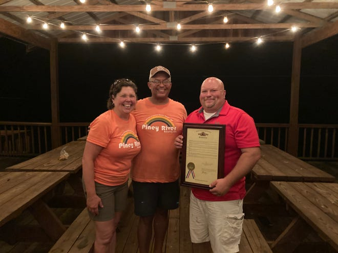State Rep. Bennie Cook, R-Houston, presented a resolution to the owners of Piney River Brewing Company, Brian and Joleen Durham.