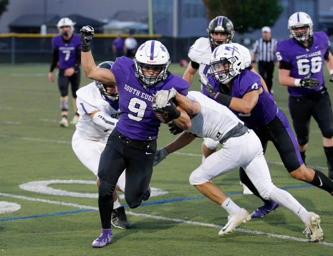 South Eugene running back Orion Garcia breaks a pair of arm tackles during a nonleague football game against Ridgeview in 2019
