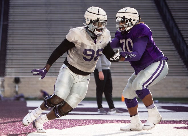 Kansas State defensive tackle Timmy Horne (98) works against offensive lineman KT Leveston during practice at Bill Snyder Family Stadium.