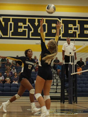 The Bees' Kennedy Coffee (No. 4) sets the ball as Kierstyn Carlton (No. 12) gets ready to spike it over the net during their Tuesday match against Godley. SHS shut out Godley, 3-0. On Thursday, the Bees went 2-1 at the Granbury Classic Chevrolet Tournament. They defeated East View and Paschel, 2-0, before falling to Midlothian High, 0-2.
