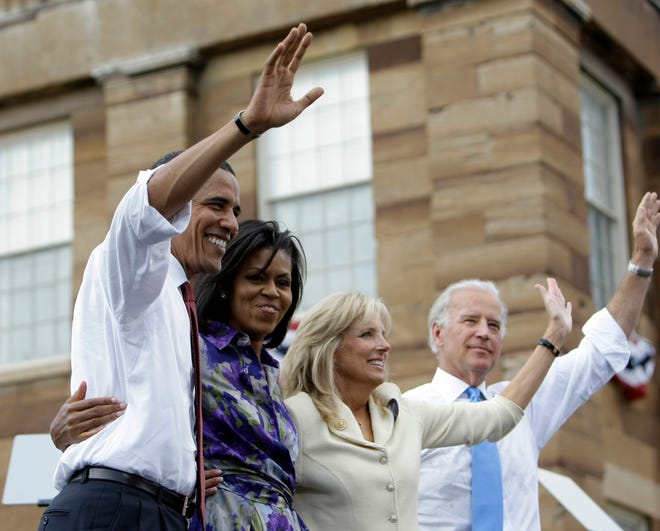 Democratic presidential candidate Sen. Barack Obama, D-Ill., left, with his wife, Michelle Obama, Jill Biden, and vice presidential running mate Sen. Joe Biden, D-Del., wave in front of the Old State Capitol in Springfield on Aug. 23, 2008. Obama introduced Biden as his running mate during the event.