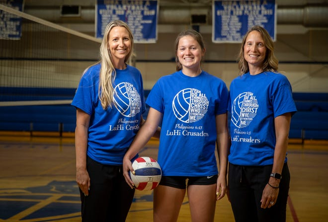 It's a family affair for Lutheran Volleyball as head coach Katie McCulley, left, is assisted by her sister Michelle Cox, right, in coaching the Crusaders including McCulley's niece and Cox's daughter, Makenna Cox, center. [Justin L. Fowler/The State Journal-Register]