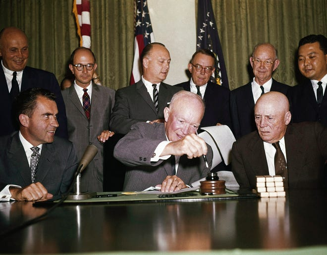 President Dwight D. Eisenhower signs an order making Hawaii the 50th state on Aug. 21, 1959.