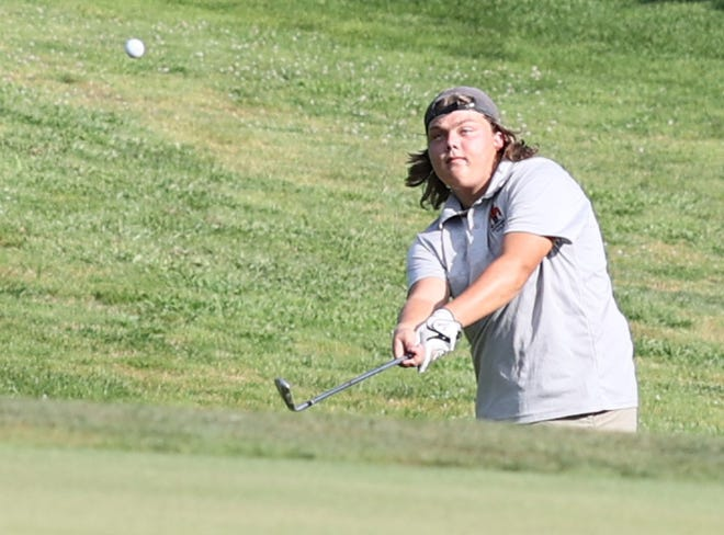 KHS golfer Chaz Peed lifts a chip shot in match play earlier this week.