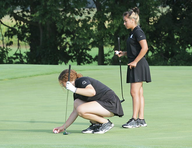 Seniors Annabelle Bucklin and Vianey Cardiel line up a putt on the 10th hole Thursday morning in prep golf action.