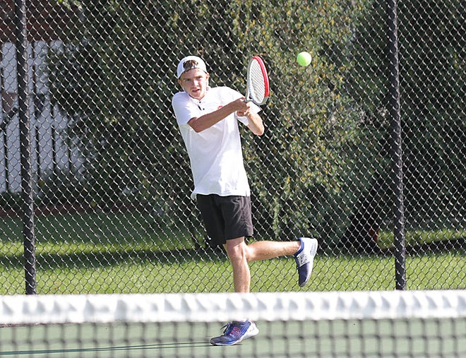 Walter Ebert hits a return shot in one of his matches during the Great 8 Invitational held in Sturgis on Thursday.