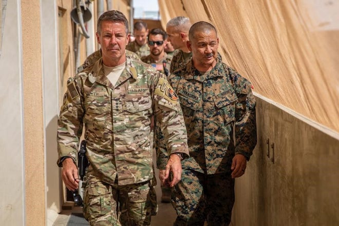 Retired Marine Col. Eric Terashima (right) is on a mission to bring the Afghan interpreters he served with in Bost, Afghanistan to the United States.
